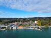 VERKAUFT: Großzügige Dachgeschosswohnung mit zwei Balkonen, Alpen- und Teilseeblick - Lage aus See-Perspektive