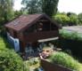 Seltene Gelegenheit: Freistehendes Einfamilienhaus mit See- und Bergsicht und Privatstrand - Haus Drohne